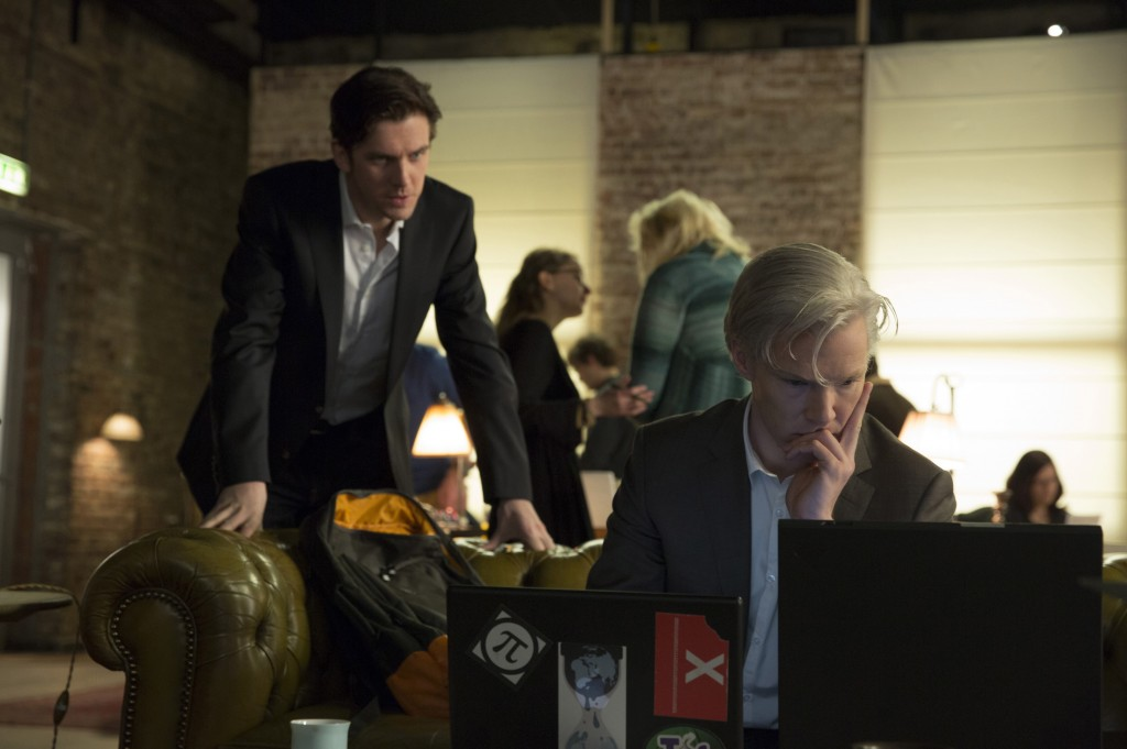 Dan Stevens is journalist Ian Katz, left, and Benedict Cumberbatch is WikiLeaks founder Julian Assange in a scene from