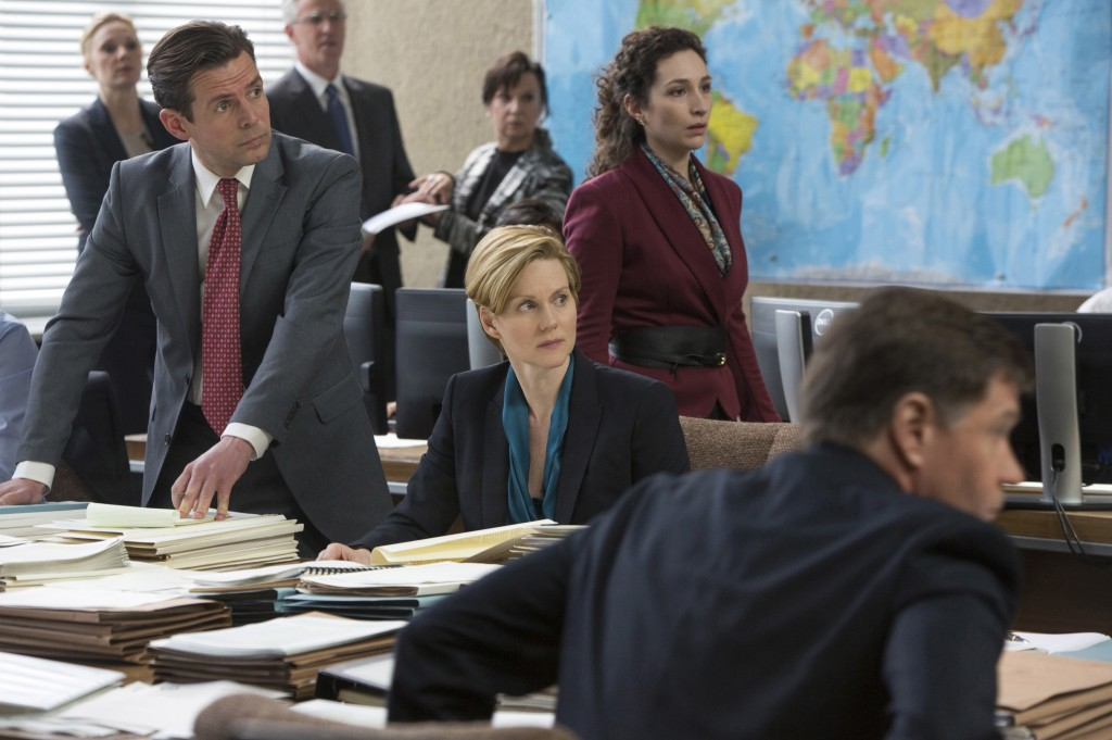 Laura Linney plays Deputy Undersecretary of State Sarah Shaw, center, in a scene from