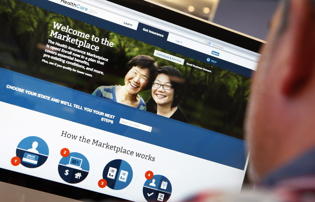 A man looks over the Affordable Care Act signup page on the www.healthcare.gov website in this photo illustration. The federal government's portal logged over 2.8 million visitors by the afternoon of Oct. 2, a day after Obamacare was launched.