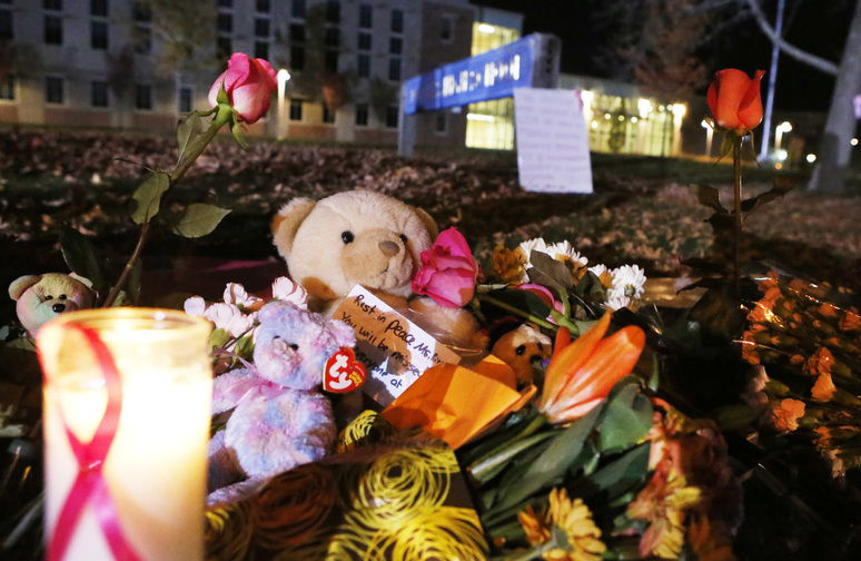 Candles and teddy bears are placed at Danvers High School prior to a candlelight vigil to mourn the death of Colleen Ritzer, a 24-year-old math teacher at Danvers High School on Wednesday in Danvers, Mass. Ritzer was found slain in woods behind the high school, and Danvers High School student Philip Chism, 14, was charged with killing her.