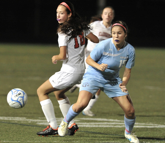 Elise O'Reilly of Scarborough, left, and Ciera Berthiaume of Windham watch the ball bounce away Wednesday night during their 2-2 tie in an SMAA schoolgirl soccer game.