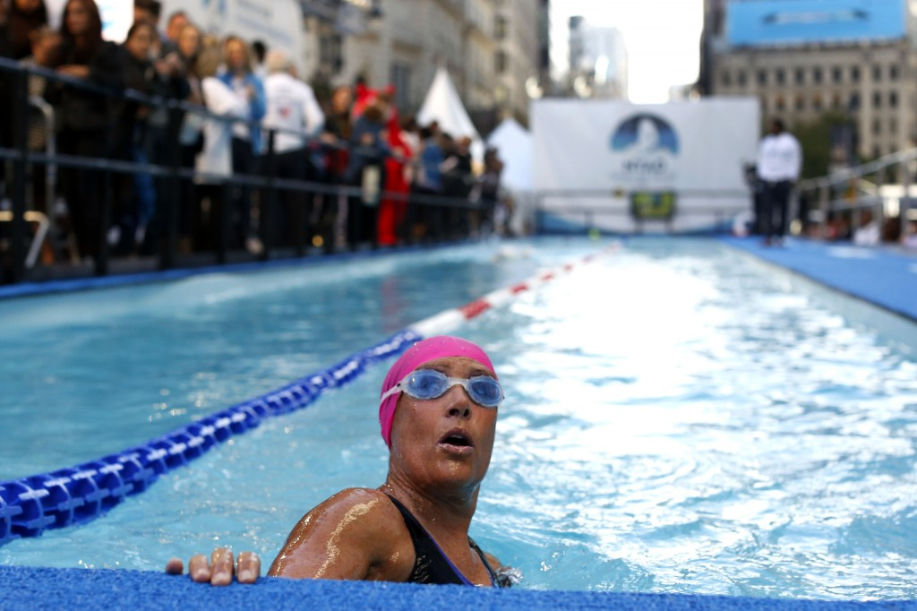 "Long-distance swimmer Diana Nyad, who recently completed a record-setting swim from Cuba to Florida, completes a lap during a continuous 48-hour marathon swim event in New York's Herald Square Tuesday called ""Swim for Relief,"" which aims to raise funds and awareness for Superstorm Sandy recovery efforts."