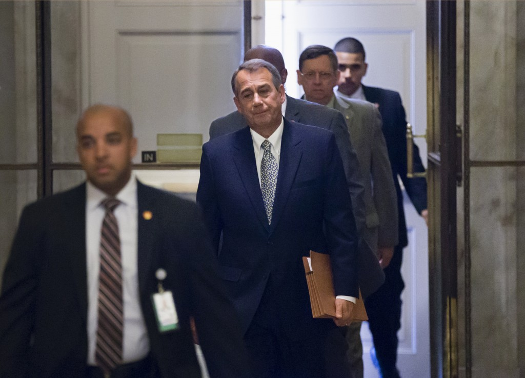House Speaker John Boehner of Ohio arrives on Capitol Hill in Washington on Monday. The Republican-controlled House and the Democratic-controlled Senate are at an impasse, neither side backing down, after House Republican conservatives linked the funding bill to President Obama's existent health care law.