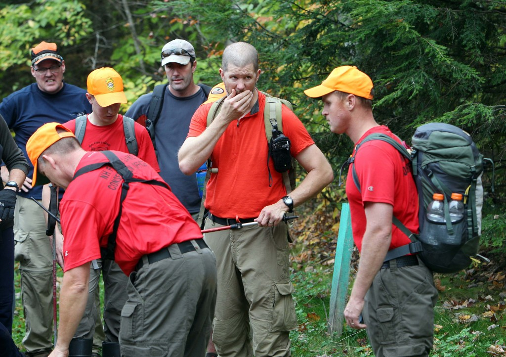 The Associated Press New Hampshire Fish and Game personnel and volunteers take a break after searching the woods for 14-year-old Abigail Hernandez on Friday in North Conway, N.H.