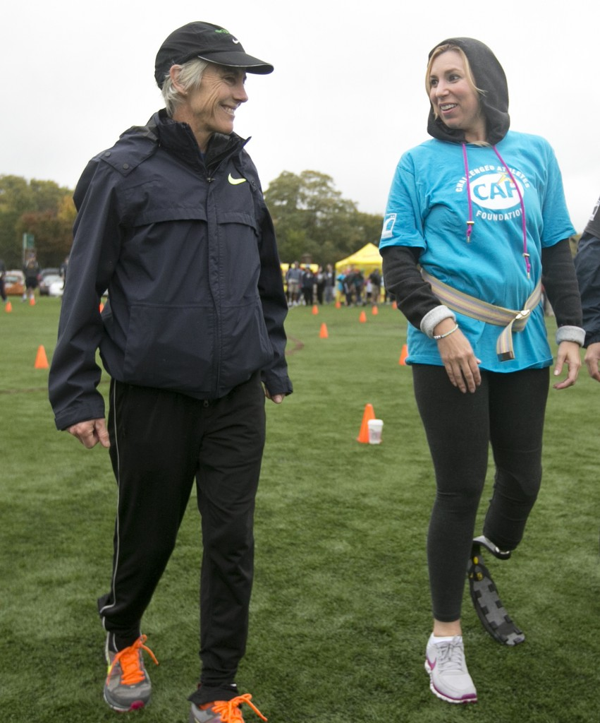 Two-time Boston Marathon winner Joan Benoit Samuelson, left, talks with Heather Abbott, who lost part of her left leg in the Boston Marathon explosion, during a running clinic Sunday in Cambridge, Mass.