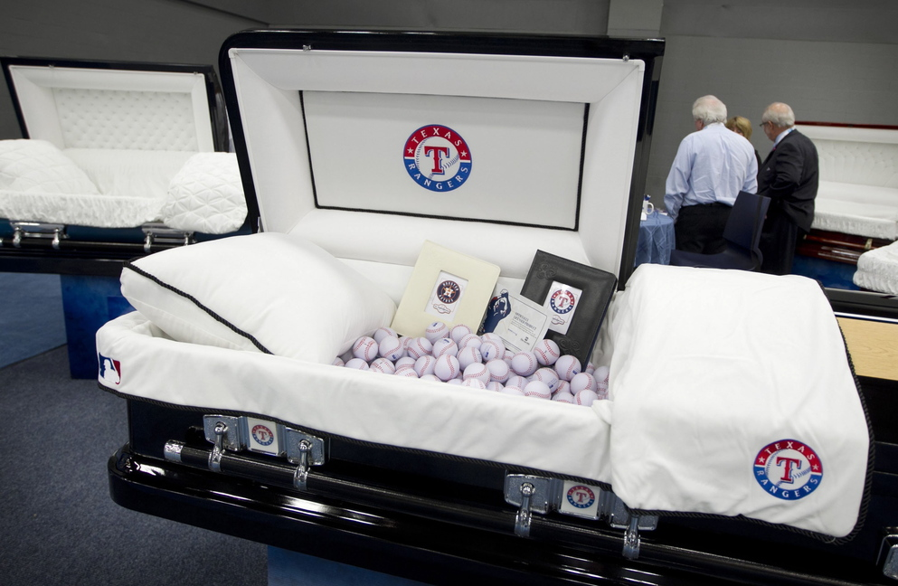 A casket with a Texas Rangers theme is displayed at the National Funeral Directors Association International Convention and Expo in Austin, Texas, on Tuesday. You could, alternatively, be buried at sea in an urn made of salt, or have your ashes scattered from a helium balloon.