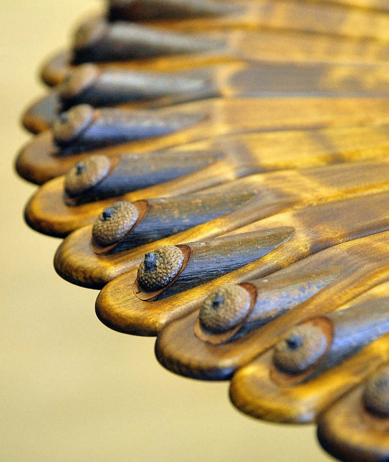 Randy Holden of Norridgewock creates unique furniture using the existing curves and characteristics of the natural wood. This table uses acorn shells as decoration.