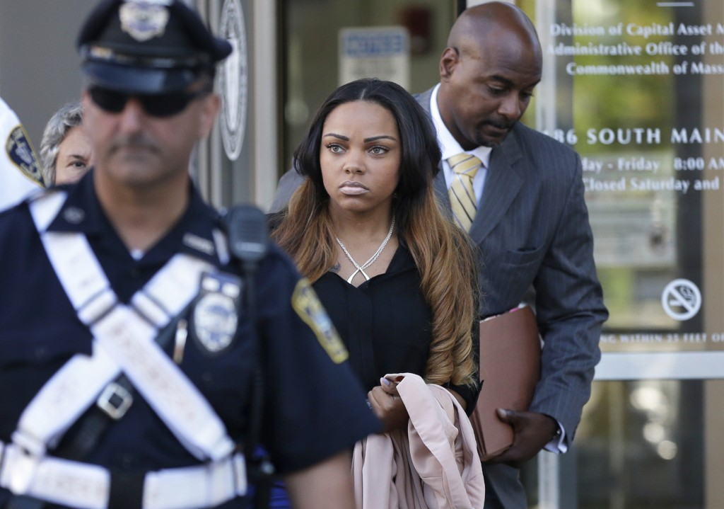 Shayanna Jenkins, girlfriend of former New England Patriot Aaron Hernandez, leaves court Tuesday in Fall River, Mass., after her arraignment on a perjury charge for allegedly lying to a grand jury, including about disposing of evidence in the murder case against Hernandez.