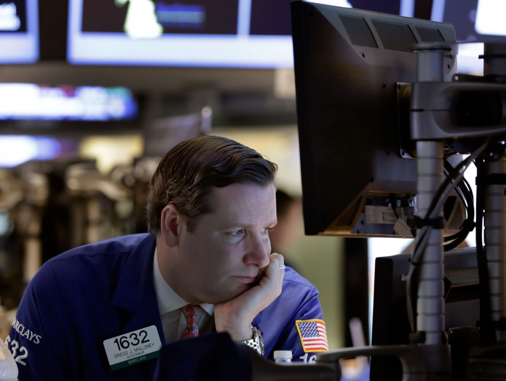 Specialist Gregg Maloney works at his post on the floor of the New York Stock Exchange Thursday, Oct. 31, 2013. Stocks were mixed on Wall Street Thursday, keeping the market's big gain for October in check, as investors assessed some disappointing corporate earnings.