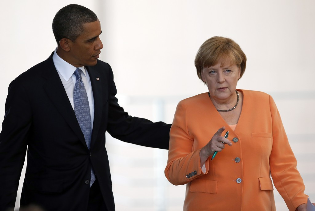 In June, President Barack Obama, left, and German Chancellor Angela Merkel arrive for a news conference at the chancellery in Berlin. Reports based on leaks from former NSA systems analyst Edward Snowden suggest the U.S. has monitored the telephone communications of 35 foreign leaders, including Merkel.