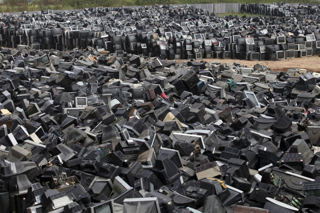 Discarded television sets pile up in a scrap yard awaiting recycling in Zhuzhou city in south China's Hunan province. China's recycling industry has boomed over the past 20 years. Its manufacturers needed the metal, paper and plastic and Beijing was willing to tolerate the environmental cost.