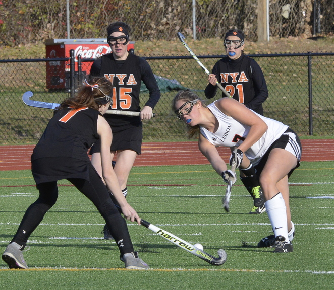 John Patriquin/StaffPhotographer Lisbon's Molly Nicholson hits the ball past NYA's Charlotte Eisenberg as North Yarmouth Academy and Lisbon play for the Western Class C field hockey championship at Thornton Academy in Saco. NYA won the game, 2-1.