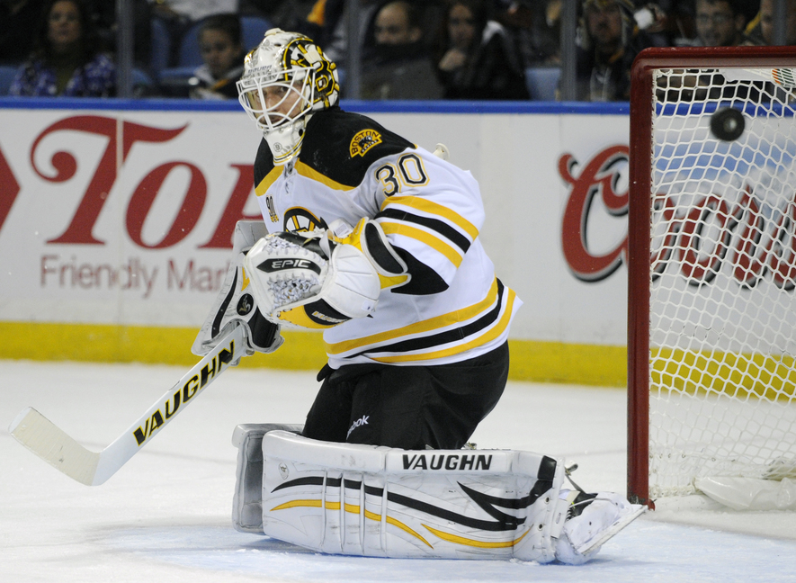 Bruins goaltender Chad Johnson deflects the puck wide of the goal in Wednesday's game against the Sabres at Buffalo, N.Y. The Bruins won, 5-2.