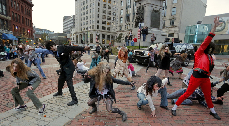 "About 40 people responded to a Facebook invitation to create a zombie flash mob in Portland's Monument Square, and they successful staged a fully-costumed performance of Michael Jackson's hit song and dance video, ""Thriller."""