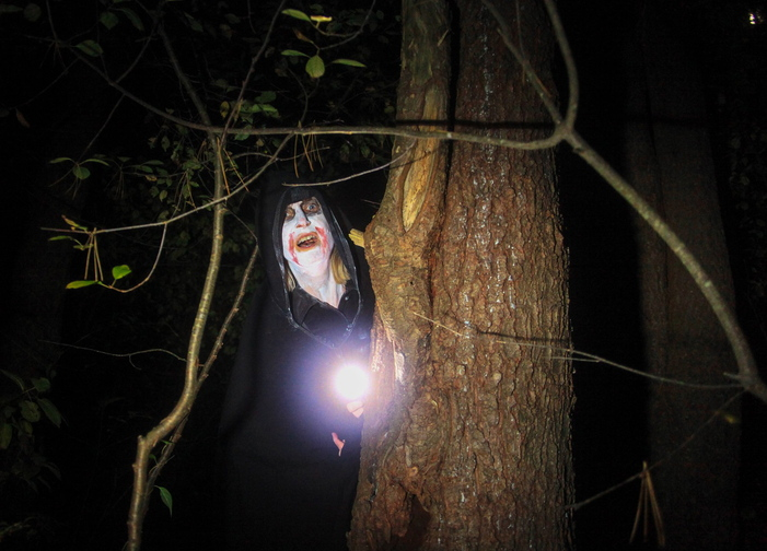 "Jill Brady/Staff Photographer A ghoulish zombie lurks in the woods along Steve Workman's ""Night Terror"" haunted walk at Take Flight Ariel Adventures in Kittery Sunday, October 13, 2013."