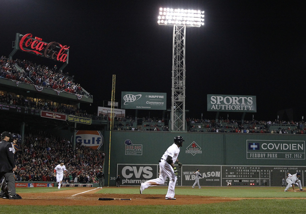 David Ortiz watches his grand slam clear the fence in the eighth inning Sunday night, igniting Boston's comeback for a 6-5 victory in Game 2 of the AL Championship Series against the Tigers. The series now shifts to Detroit for the next three games.