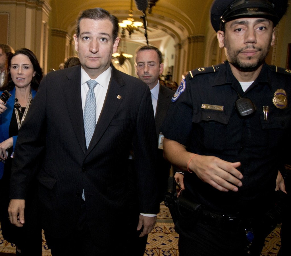 "Sen. Ted Cruz, R-Texas, walks with security after talking to reporters on Capitol Hill on Wednesday. A number of Republicans have castigated Cruz during the shutdown impasse, including Rep. Peter King, R-N.Y., who said Cruz was ""fraudulent from the start."""