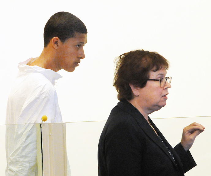Philip Chism, 14, stands during his arraignment for the death of Danvers High School teacher Colleen Ritzer as his attorney Denise Regan speaks on his behalf in Salem District Court in Salem, Mass., Wednesday. Chism was ordered held without bail.