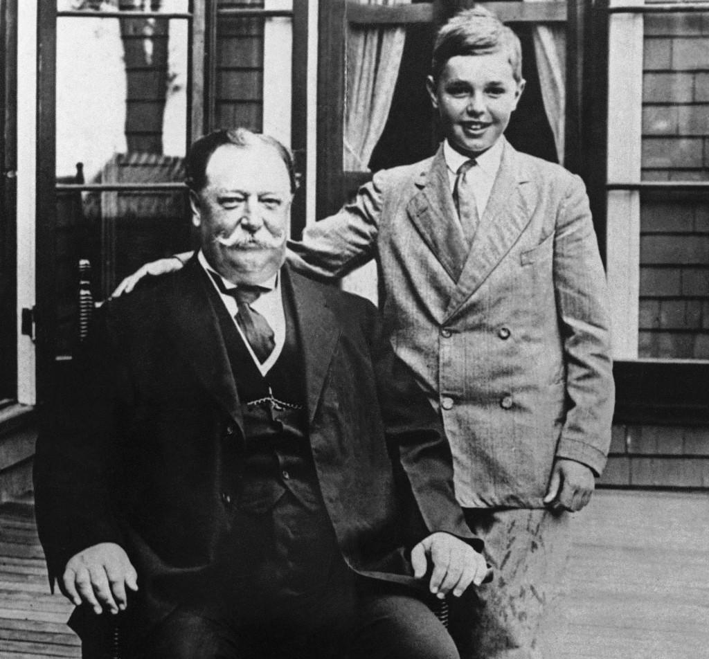 President William Howard Taft poses for a photo with his son Charles while on vacation in Beverly, Mass. Taft's weight, at times well over 300 pounds, made headlines.
