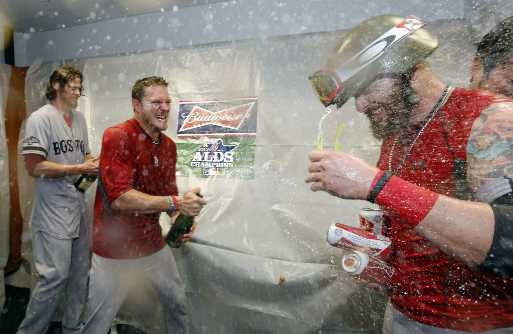 Boston Red Sox's players celebrate their victory over the Tampa Bay Rays in Game 4 of an American League baseball division series, Wednesday, Oct. 9, 2013, in St. Petersburg, Fla. The Boston Red Sox's defeated the Tampa Bay Rays 3-1 to move on to the American League Championship Series.