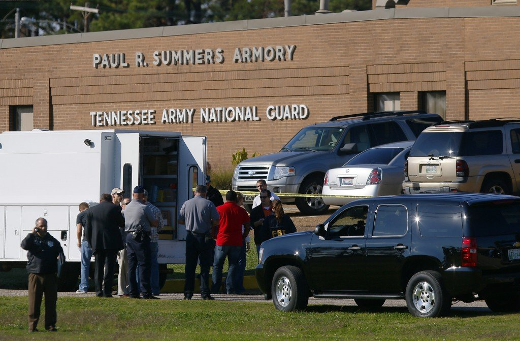 Law enforcement and military personnel investigate the scene where shootings occurred at an armory outside a U.S. Navy Base in Millington, Tenn., on Thursday.