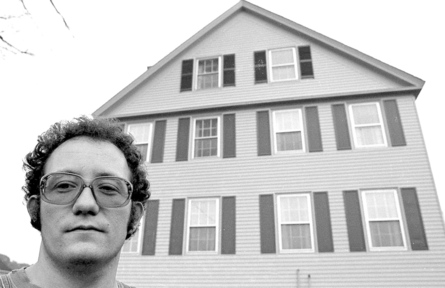 Alan Linnell, stands in front of his reportedly haunted house on Falls Road in Benton, in 1977.