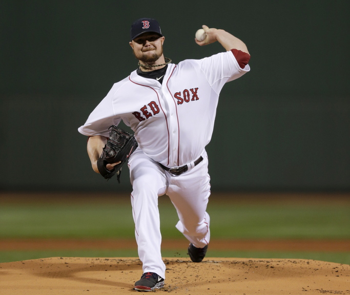 Boston Red Sox starting pitcher Jon Lester throws during the first inning of Game 1 of baseball's World Series against the St. Louis Cardinals on Oct. 23 in Boston. He pitched 7- shutout innings, allowing five hits and one walk. He struck out eight.