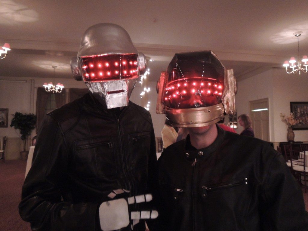 Chad Cote, of Windham, and Ellis Baum, of Saco, lit up the room as techno band Daft Punk, representing event sponsor Clark Insurance.