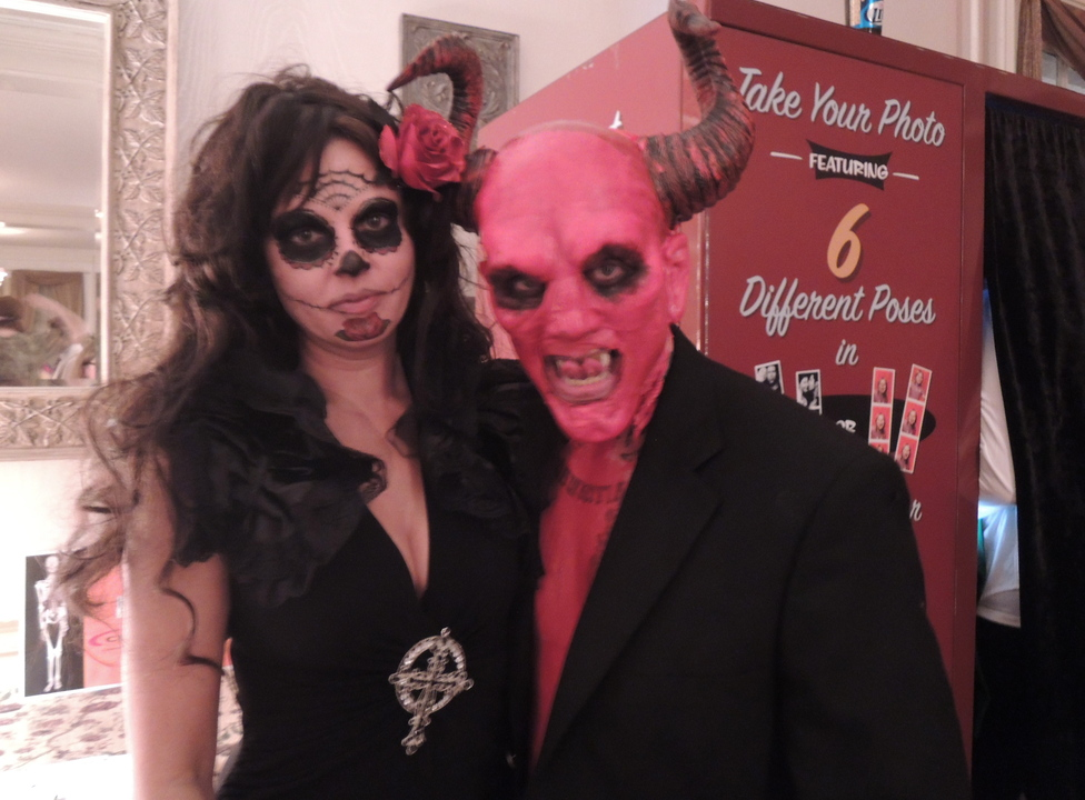 Portland residents Erica Ouellet in Day of the Dead garb, with devil John Aday, in the grand prize-winning costume.
