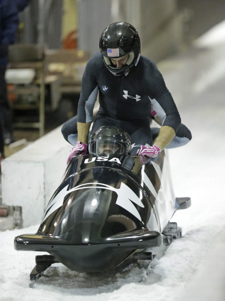 From front to back, Steve Holcomb and Curt Tomasevicz come to a stop after racing in the United States four-man bobsled team trials on Saturday. Holcomb and his crew came in first place.