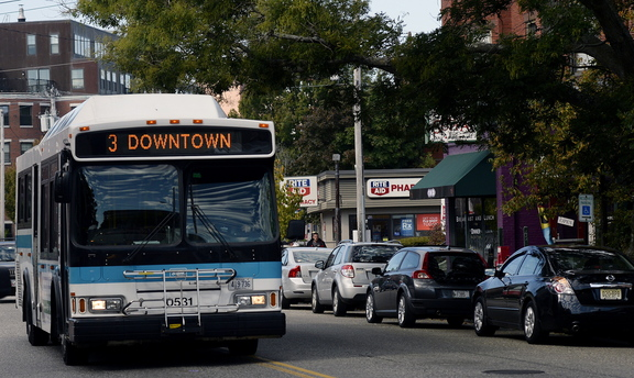 A Metro bus runs along Congress Street in Portland. Greater Portland Transit District officials plan to apply for a federal grant that would help fund expanded service. The rest would come from local sources.
