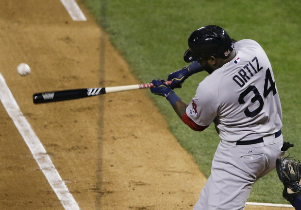 Boston Red Sox designated hitter David Ortiz singles off of St. Louis Cardinals starting pitcher Adam Wainwright during the fourth inning of Game 5 of baseball's World Series Monday, Oct. 28, 2013, in St. Louis.