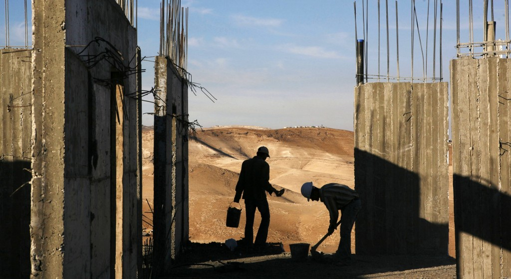 Israel on Wednesday announced plans to build 1,500 new homes in east Jerusalem, the part of the city claimed by the Palestinians, just hours after it freed a group of Palestinian prisoners as part of a deal to set peace talks in motion.