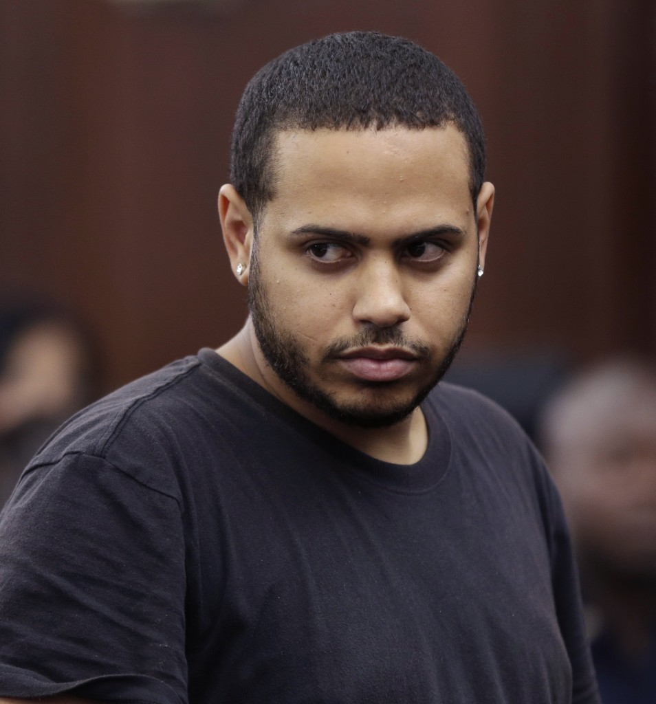 Christopher Cruz appears in criminal court in New York Wednesday. Cruz, 28, of New Jersey, was charged with reckless driving after prosecutors said he touched off a tense encounter with the driver of a sport utility vehicle and a throng of other bikers that ended with blood and broken bones on a Manhattan street.