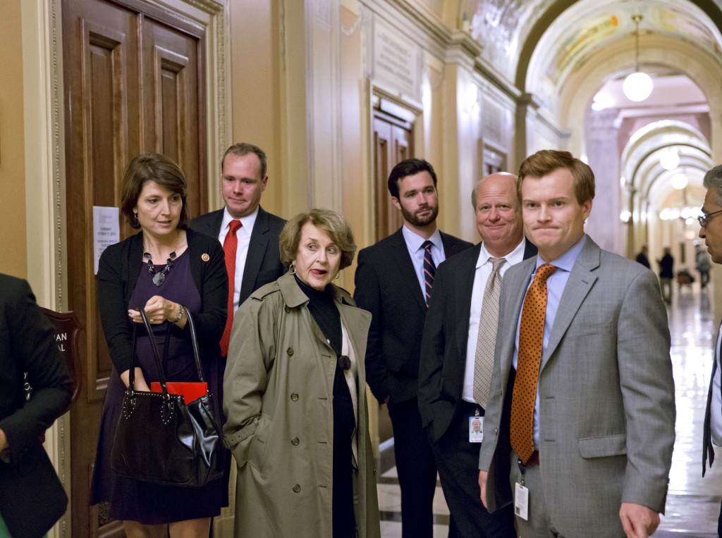 House members and congressional staff, including Rep. Cathy McMorris Rodgers, R-Wash., left, head of the Republican Conference, left, moving past Rep. Louise Slaughter, D-N.Y., third from left, the top Democrat on the House Rules Committee, leave the Capitol at the end of the night after a planned vote in the House of Representatives collapsed, Tuesday, Oct. 15, 2013, at the Capitol in Washington. Time growing desperately short, House Republicans pushed for passage of legislation late Tuesday to prevent a threatened Treasury default, end a 15-day partial government shutdown and extricate divided government from its latest brush with a full political meltdown.