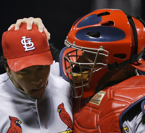 St. Louis Cardinals relief pitcher Carlos Martinez, left, and catcher Yadier Molina react during the eighth inning of Game 2 of baseball's World Series against the Boston Red Sox Thursday, Oct. 24, 2013, in Boston. (AP Photo/Matt Slocum)