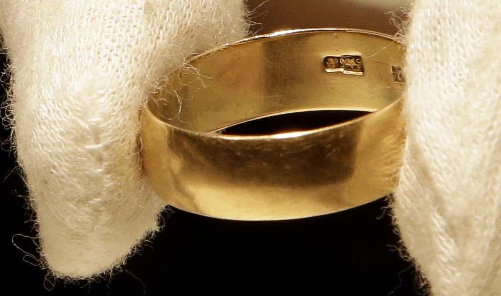 "Lee Harvey Oswald's wedding ring, which he left at his wife Marina Oswald's bedside the morning of the assassination of President John F. Kennedy, was part of a themed JFK memorabilia auction ""Camelot: Fifty Years After Dallas"" at the Omni Parker House hotel in Boston. Engraved on the inside of the ring is a Star of Russia."