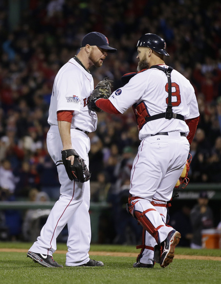Boston Red Sox starting pitcher Jon Lester, left, and catcher David Ross react following a double play during the fourth inning of Game 1 of baseball's World Series against the St. Louis Cardinals Wednesday, Oct. 23, 2013, in Boston. (AP Photo/Matt Slocum)