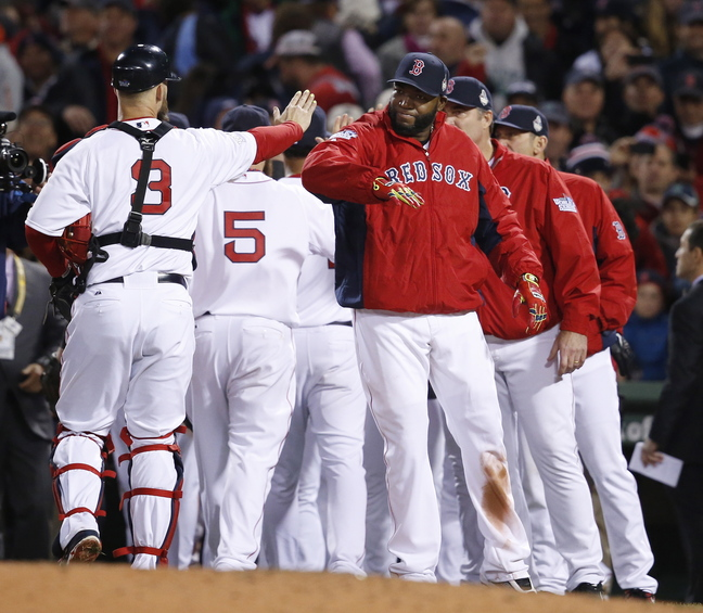 Boston Red Sox catcher David Ross (3) and David Ortiz, right, celebrate with teammates after the Red Sox defeated the St. Louis Cardinals, 8-1, in Game 1 of baseball's World Series Wednesday in Boston.