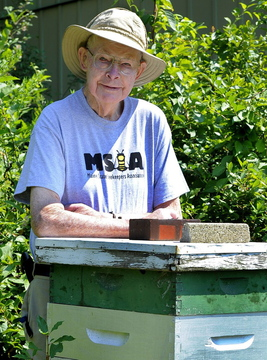 Stan Brown, the owner of a beekeeping business near where Sunday's shooting took place, says the alleged gunman had been banned from the property.