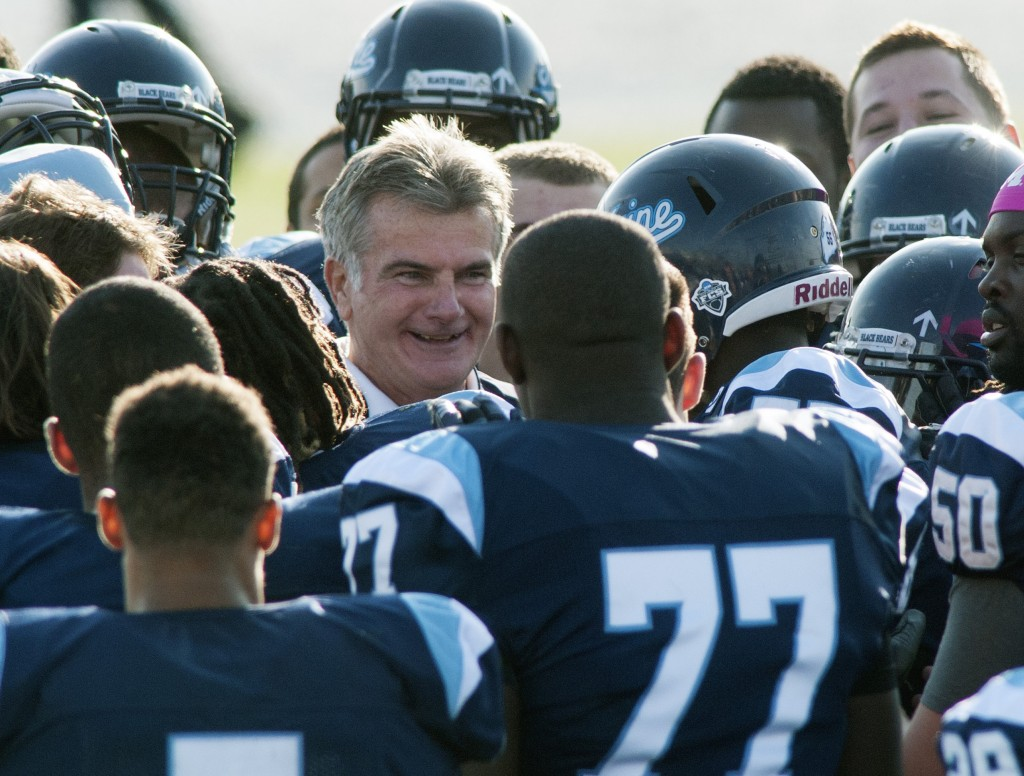 Maine Coach Jack Cosgrove, center, celebrates with his players Saturday after their 34-20 victory against William & Mary. The Black Bears are 6-1 overall and 3-0 in the CAA.