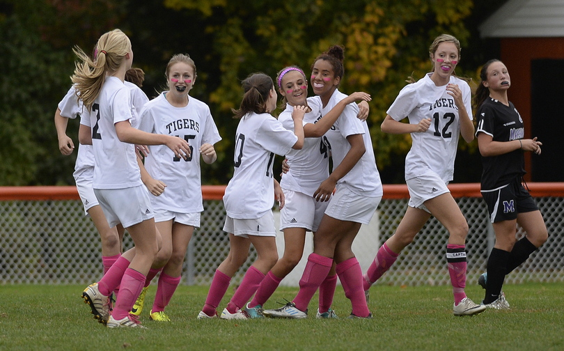 Biddeford celebrates after Lexi Paquette scored one of the two first-half goals for Biddeford against Marshwood.