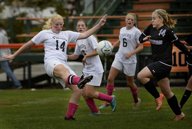 Ryanne Desjardins of Biddeford kicks the ball down the field as Hannah Folger of Marshwood moves in Wednesday during Biddeford's 3-1 victory at home.