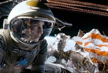 "Sandra Bullock and, below, George Clooney find trouble in outer space in ""Gravity."""