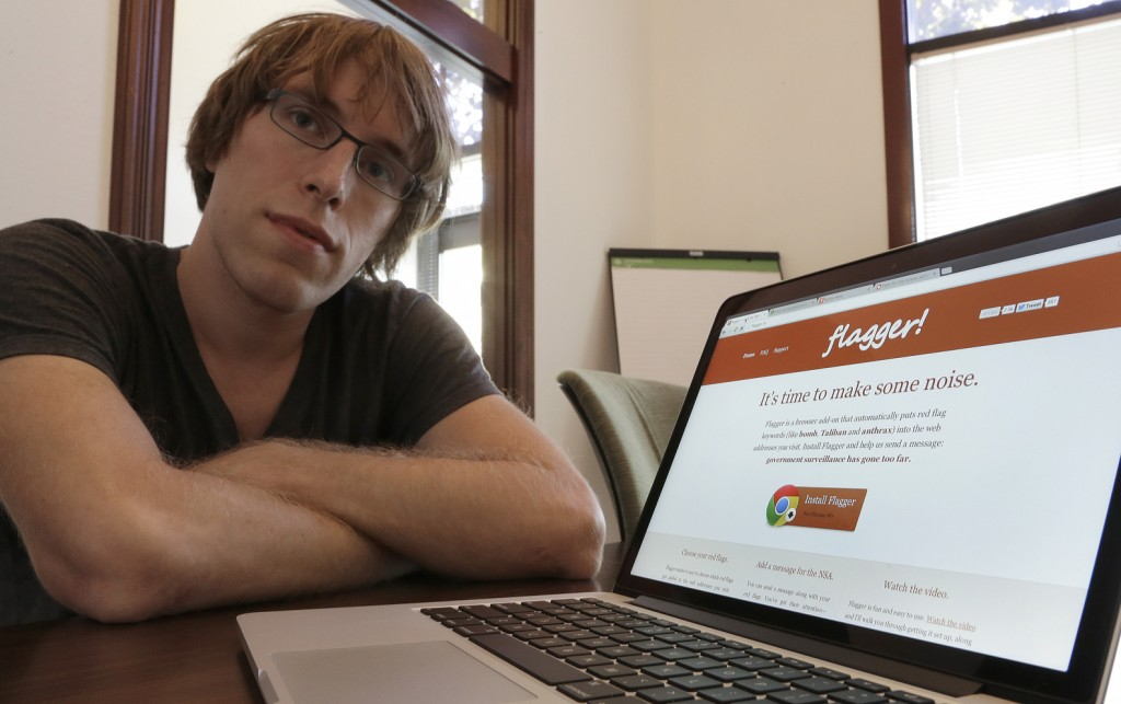 """Software engineer and entrepreneur Jeff Lyon sits next to a computer showing the Flagger program he developed in San Jose, Calif. Lyon came up with the software that adds words like """"blow up"""" and """"pressure cooker"""" to Web addresses that users visit."""