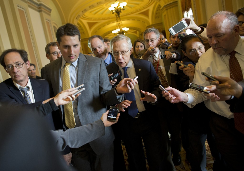 "Senate Majority Leader Sen. Harry Reid, D-Nev., is surrounded by reporters after leaving the office of Senate Minority Leader Sen. Mitch McConnell, R-Ken., on Capitol Hill on Monday in Washington. ""We're getting closer,"" Reid told reporters."