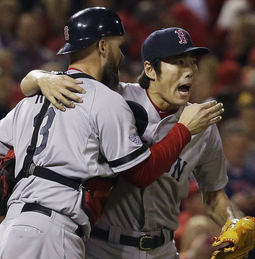 Red Sox closer Koji Uehara hugs catcher David Ross after closing out the Cardinals in the ninth inning Monday night. Ross broke a 1-1 tie with an RBI double in the seventh inning, helping Boston to a 3-1 win. The Sox are home Wednesday night with a chance to celebrate.