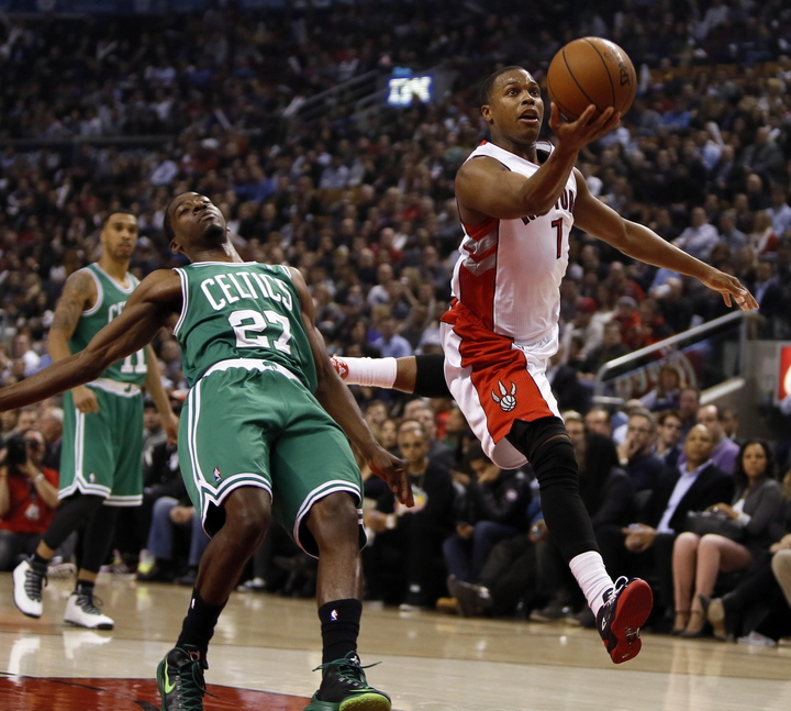 Kyle Lowry drives to the net past Boston guard Jordan Crawford during the Raptors' 93-97 win Wednesday in Toronto.