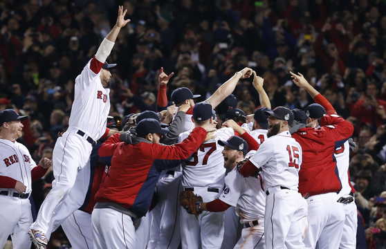 Boston Red Sox players celebrate after defeating the St. Louis Cardinals in Game 6 of the World Series on Wednesday at Fenway Park in Boston.