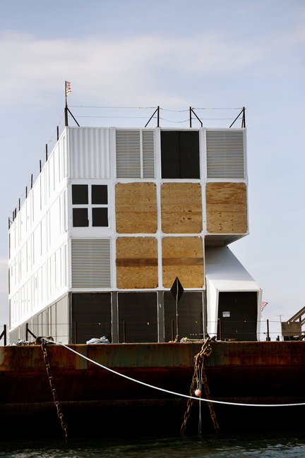 The barge holding a four-story structure made of shipping containers sits Monday in Portland Harbor. There are signs it may be a floating data center for Internet giant Google.